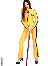 Long hair brunette stripping in a kill bill outfit