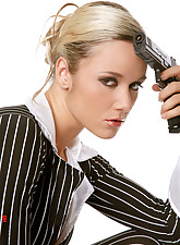 Blond Jana playing with a gun