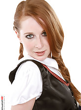 Redhaired beauty gets rid off a bavarian costume