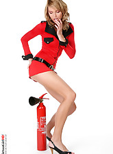 Blond beauty stripping with a fire extinguisher
