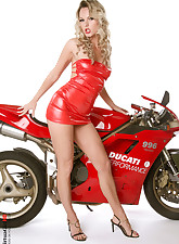 Blond beauty, red latex dress, red moto