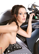 Carla Pacini stripping in boots with a moto
